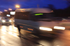 Motion blurred minibus. In the evening on the street stock photography