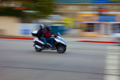 Motion Blurred moped Stock Photography