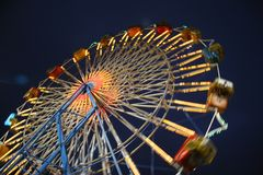 Motion Blurred Night Time Ferris Wheel Stock Image