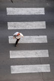 Businessman on crosswalk Royalty Free Stock Photo