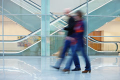 Motion Blurred People in Front of Escalator Royalty Free Stock Photography
