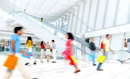 Motion Blurred People in the Shopping Mall.  Royalty Free Stock Image