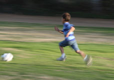 Motion blurred photo of boy running Royalty Free Stock Photos