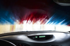 Motion blurred picture of car wash from inside a car during the Royalty Free Stock Images