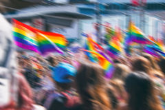 Motion blurred picture of gay rainbow flags. During pride parade. Concept of LGBT rights royalty free stock images