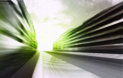 Motion blurred racetrack in business city wallpaper Royalty Free Stock Image
