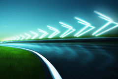Motion blurred racetrack. Night scene cold mood. with arrow light Effects Royalty Free Stock Photo