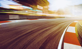 Motion blurred racetrack,sunset scene. Motion blurred racetrack,sunset scene Stock Photo