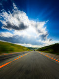 Motion blurred road Stock Photos