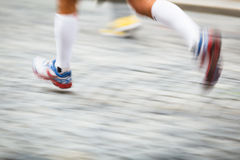 Motion blurred runner's feet in a city environment Royalty Free Stock Photography