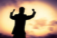 Motion blurred of Silhouette man showing his hand Royalty Free Stock Images