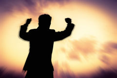 Motion blurred of Silhouette man showing his hand Stock Photo