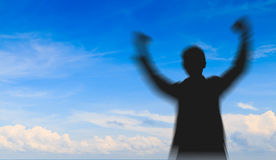 Motion blurred of Silhouette man showing his hand Royalty Free Stock Photos
