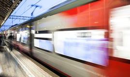 Motion blurred speed moving railroad train at railway station platform Stock Image