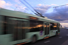 Motion blurred trolleybus. Movement of a blurred trolleybus in the city at dusk stock photography