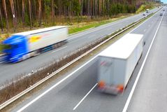 Motion blurred trucks on highway. Stock Photography