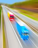 Motion blurred trucks on highway. Royalty Free Stock Image