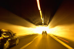 Motion blurred tunnel light with cars Royalty Free Stock Photo