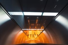Motion blurred view of an escalator Stock Photography