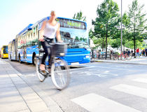 Motion blurred woman on bike. Stock Photography