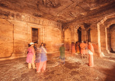 Motion blurs from moving tourists inside the 6th century Hindu stone temple Stock Photography