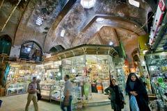 Motion blurs of rushing women and men inside the old bazaar. TEHRAN, IRAN: Motion blurs of rushing women and men inside the old bazaar  . With a population of 8 Stock Photo