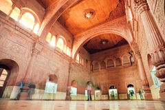 Motion blurs from walking tourists inside carved room of 16th century Junagarh Fort Stock Images