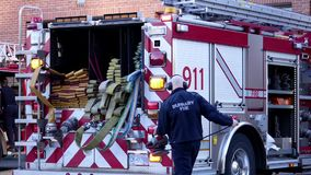 Motion of Burnaby fire emergency fire truck. With 911 sign stopping at station stock footage