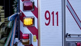 Motion of Burnaby fire emergency fire truck with 911 sign stopping. At station stock footage