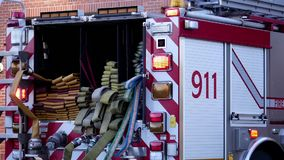 Motion of Burnaby fire emergency fire truck with 911 sign stopping stock video