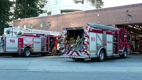 Motion of Burnaby fire emergency fire truck with 911 sign stopping stock video footage