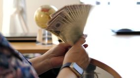 Motion of business woman counting the US dollar bills stock video footage