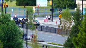Motion of busy traffic flow and people walking into park for Canada day event stock video footage