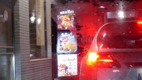 Motion of car at drive through for ordering food stock footage