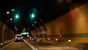 Motion of car driving inside tunnel at night. In Taipei Taiwan stock video