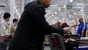Motion Of Cashier Scanning Food And Stocking Them On Trolley At Check Out Counter