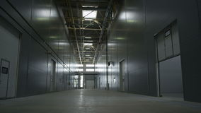 Motion from Ceiling to Floor in  Empty Plant Warehouse stock footage
