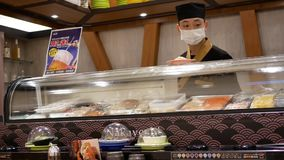 Motion of chef preparing food at sushi bar stock footage