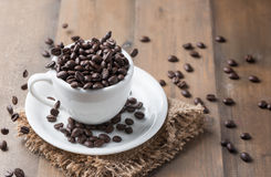 Motion coffee bean falling to white cup Stock Images