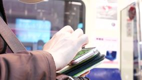 Motion of commuter taking MRT and playing game on phone. In Taipei Taiwan stock footage