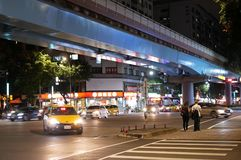 Motion of commuters crossing street to take bus or skytrain. In Taipei Taiwan Royalty Free Stock Photo