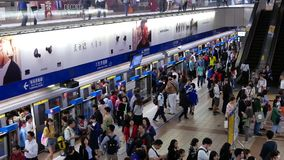 Motion of commuters walking and taking MRT during rush hour stock video footage