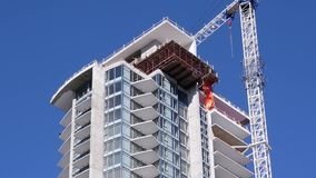 Motion of construction of new high-rise building. In city stock video