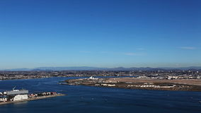 A motion controlled pan of San Diego and its harbor stock footage