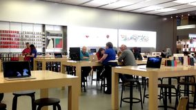 Motion of customers and shop assistants at the Apple store. stock footage