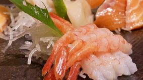 Motion of delicious plate of raw slice salmon and shrimp sashimi. In Japanese restaurant stock footage