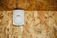 Motion detector (sensor) in action, osb background Stock Photography