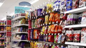 Motion of display chocolate and candy corridor. In shopper drug mart store stock video