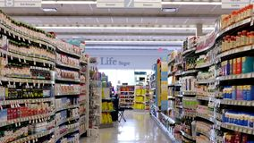 Motion of display health foods section. Inside Shoppers drug mart store stock footage