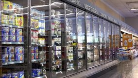 Motion of display ice cream corridor. In shopper drug mart store stock video footage
